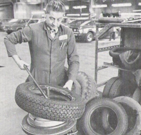 Levering a tyre off. Another SD1 and a Princess in the background.