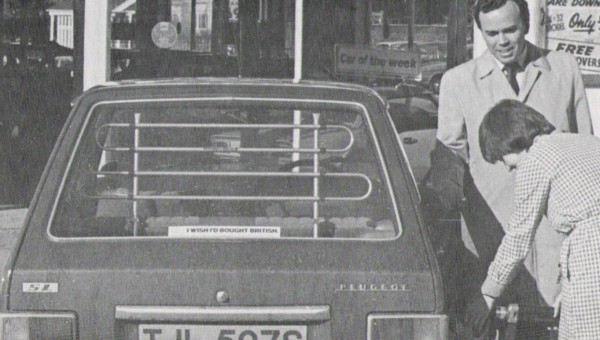 "Holland Brothers' pump attendant fills up another locally registered car, this time TJL 507S, a humble Pug 104. The owner's smiling but sounds less than satisfied with his purchase if his 'Wish I'd bought British"" sticker is anything to go by…"