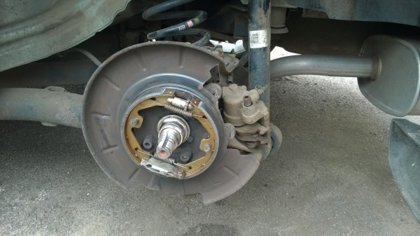 The handbrake shoes were totally knackered. Sorted after a good clean up and some new shoes - a fiddly job that wreaks havoc on your knees!