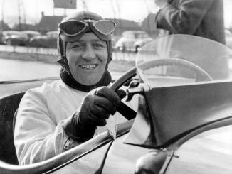 Norman Dewis OBE at the wheel of a Jaguar XK 120 in 1952