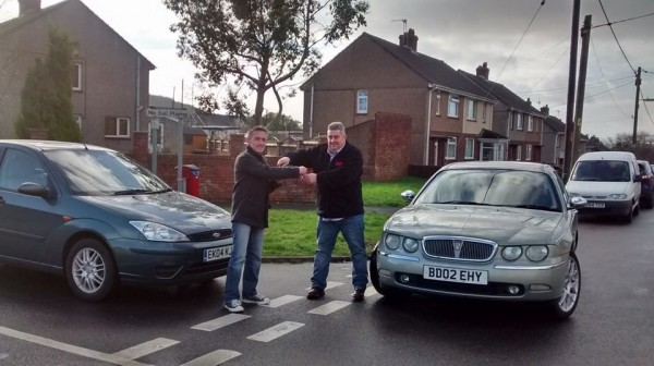 No, it's not the scene from a minor RTA but myself and Neil Rapsey sealing the deal on yet another car swap caper
