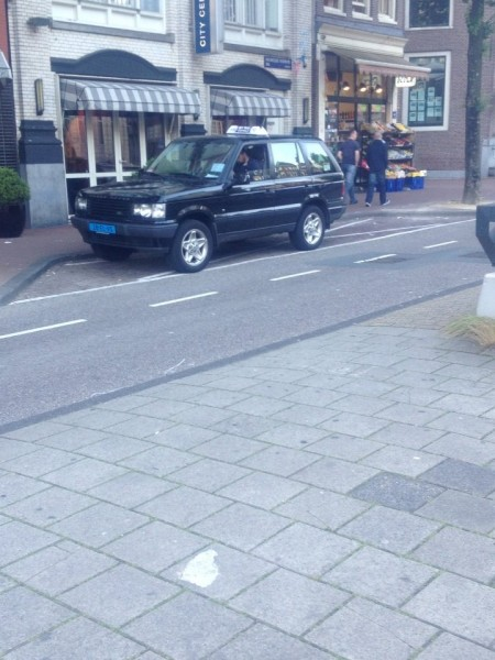 A grainy camera phone shot, but this is a genuine Amsterdam taxi. No wonder the fares are so expensive!