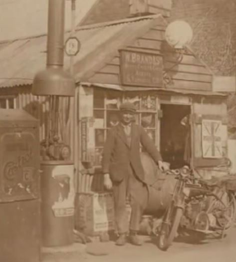 William Horace Brand, outside his bicycle workshop