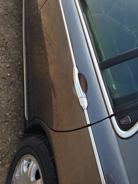 shallow parking dents mar rear door - anyone got a spare in Pewter Grey?