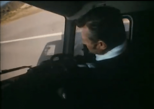An in-cab mini camera captures the moment as Gilbert throws the truck onto two wheels - while strangely looking like Duncan Banatyne as well!