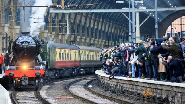 """After a 10 year overhaul. Flying Scotsman eases away from """"The Cross"""" on her 393 mile journey to Edinburgh. It wasn't smooth running though."""