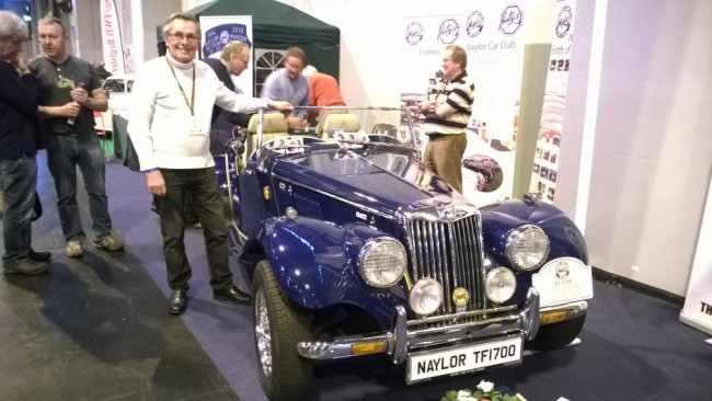 Alastair Naylor standing next to one of the 100 TF 1700s which the company built between 1984 and 1986