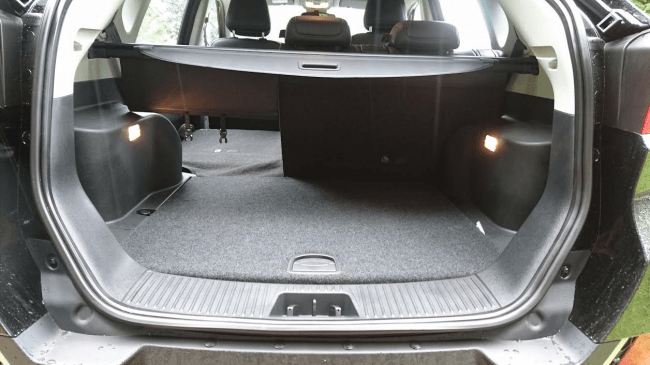 Twin boot lights are a novel feature, as is the 3 position rear backrest recline function. One touch fold action offers a totally flat floor with plenty of space for clutter.