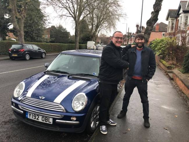 Martin Chamberlain (left) buys the April 2001 MINI One from Neil Campbell. It's all smiles...