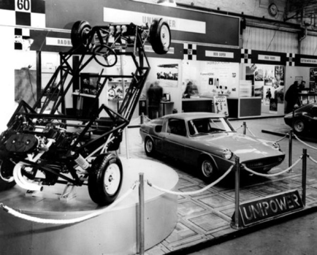 Unipower stand at the 1966 London Racing Car Show with GT spaceframe on display. Later the production car would have the radiator moved from the standard BMC Mini engine end on position to the front of the car.