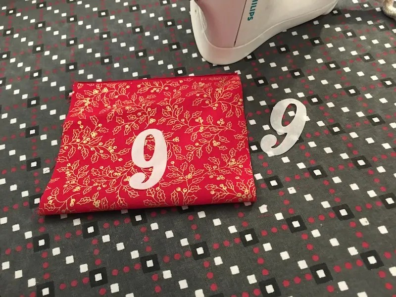 Advent Calendar Treat Bags - ironing on numbers to the bags