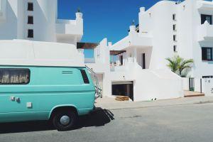 Green camper van outside Planet Surf