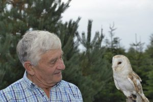 _DSC0017 Reg Hendy, owner of Langford Lakes Christmas Tree Farm, with the visiting barn owl, Honey May.