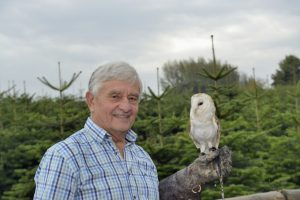 _DSC0027 Reg Hendy, owner of Langford Lakes Christmas Tree Farm, with the visiting barn owl, Honey May.