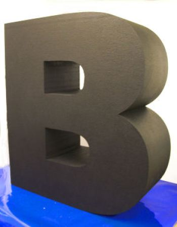 black painted polystyrene letters
