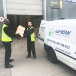 """img src=""""Arrow-Couriers-Matthew-delivering.jpg"""" alt=""""One of our uniformed driver making another successful same day delivery"""""""