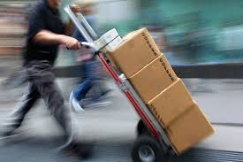 "img src=""arrow-couriers-sack-truck.jpg"" alt=""Arrow Courier Services driver using a sack truck"""
