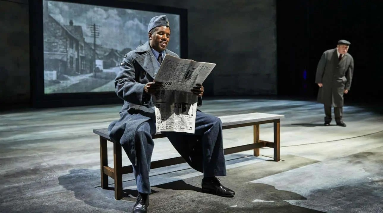 A production still from National Theatre's Small Island featuring Gershwyn Eustache Jr. and David Fielder.