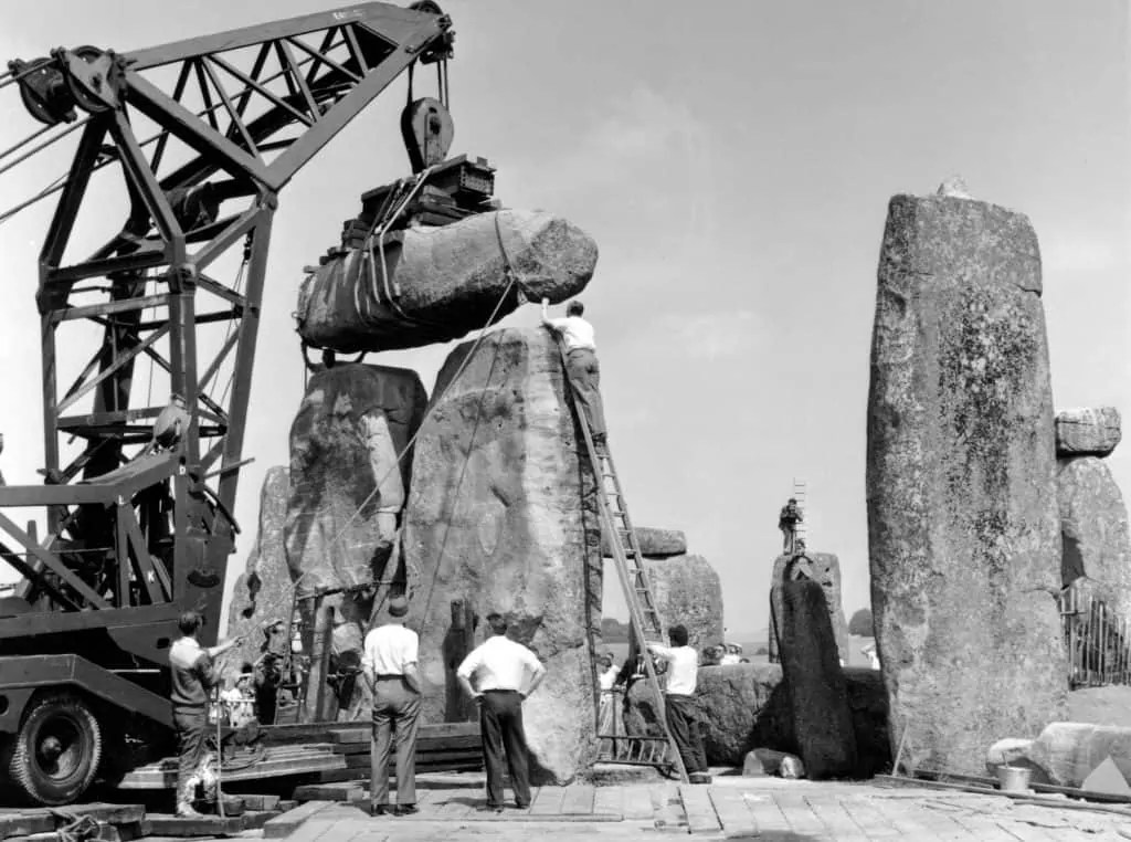 black and white photo of repairs to Stonehenge in the 1950s