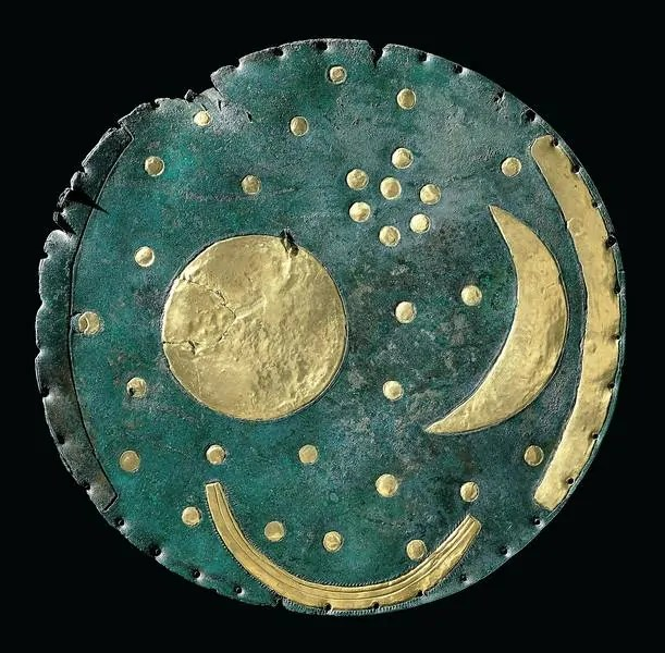 The Nebra Sky Disk showing gold start patterns on a blue bronze disk