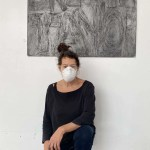 """Artist Nancy Rubins kneels beneath an artwork bearing Bronna Taylor's name for """"Show Me the Signs"""""""