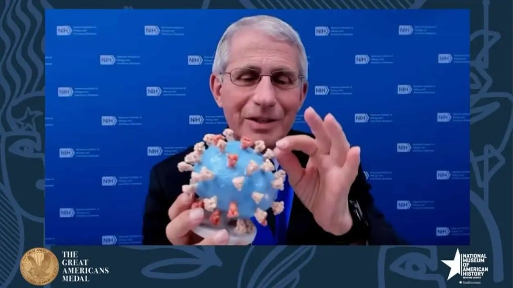 US Dr Fauci holds 3D printed version of the coronavirus that has been given to the National Museum of American History Art World Roundup