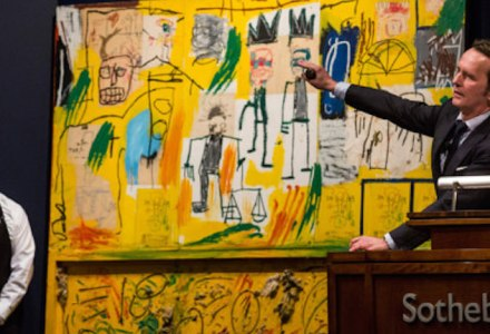 "NEW YORK, NY - NOVEMBER 13: Jean Michel Basquiat's artwork titled ""Untitled (Yellow Tar and Feathers)"" is auctioned at Sotheby's for $25,925,000 on November 13, 2013 in New York City. The big seller of the night was Andy Warhol's artwork, ""Silver Car Crash (Double Disaster)"" which sold for $104,445,000, a record for the famed artist.. (Photo by Andrew Burton/Getty Images)"