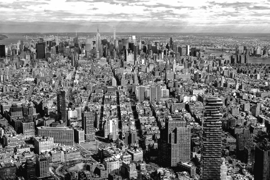 A black and white photo of a city skyline