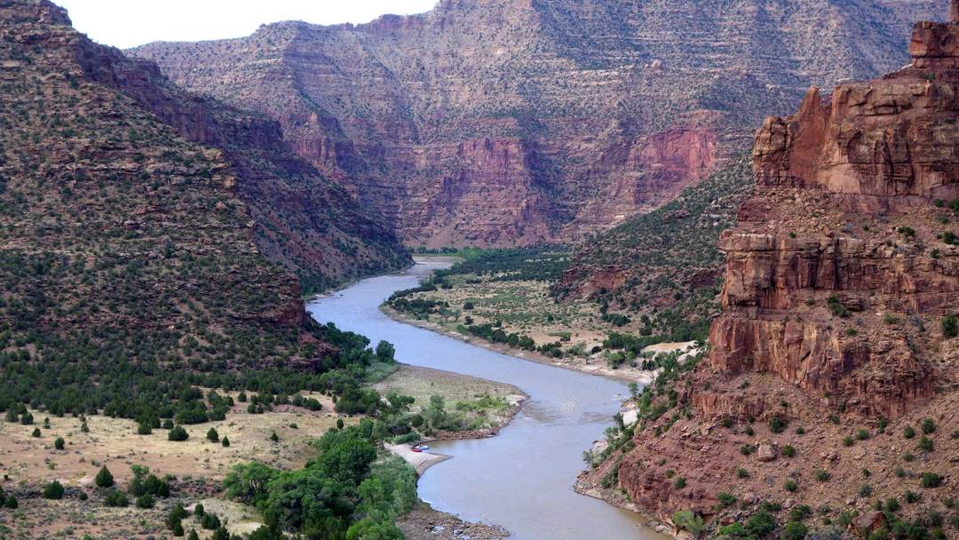 Downstream view of the river while whitewater rafting on the Green River in Desolation Canyon in Utah with ARTA river trips
