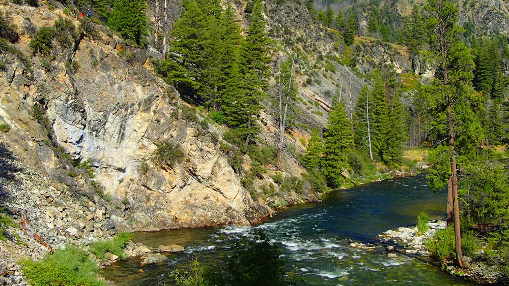 Hikers overlook the river while whitewater rafting on the Middle Fork Salmon River in Idaho with ARTA river trips