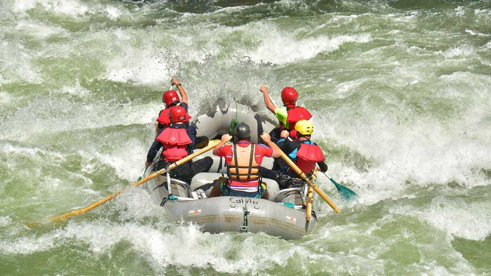 an oar-paddle raft whitewater rafting on the Merced River in California with ARTA river trips