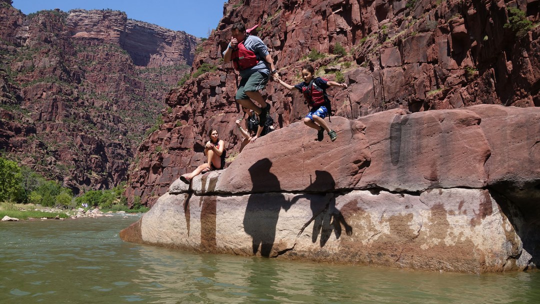 Jumping off of a rock into the Green River in Dinosaur National Monument
