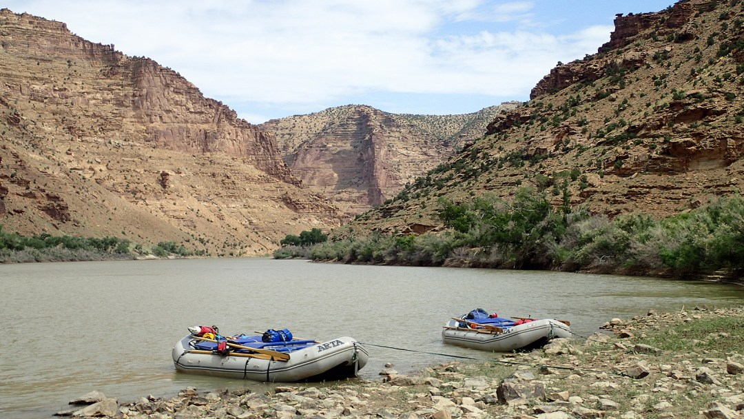 Two rafts along shore on the Green River in Desolation Canyon