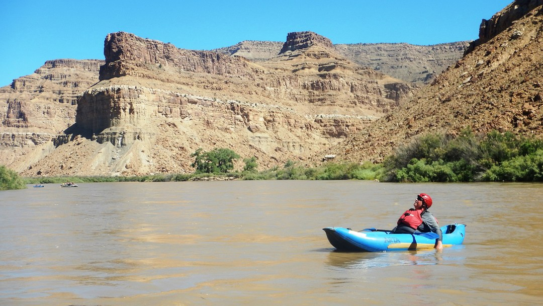 An inflatable kayak enjoys the scenery along the Green River in Desolation Canyon
