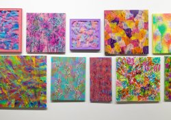A cluster of mixed media paintings