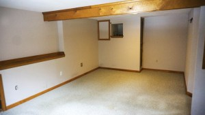 Finished basement room makes a spacious office or extra room