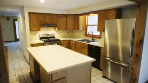 Kitchen features a tile floor and new Maytag fridge and stove and Bosch dishwasher