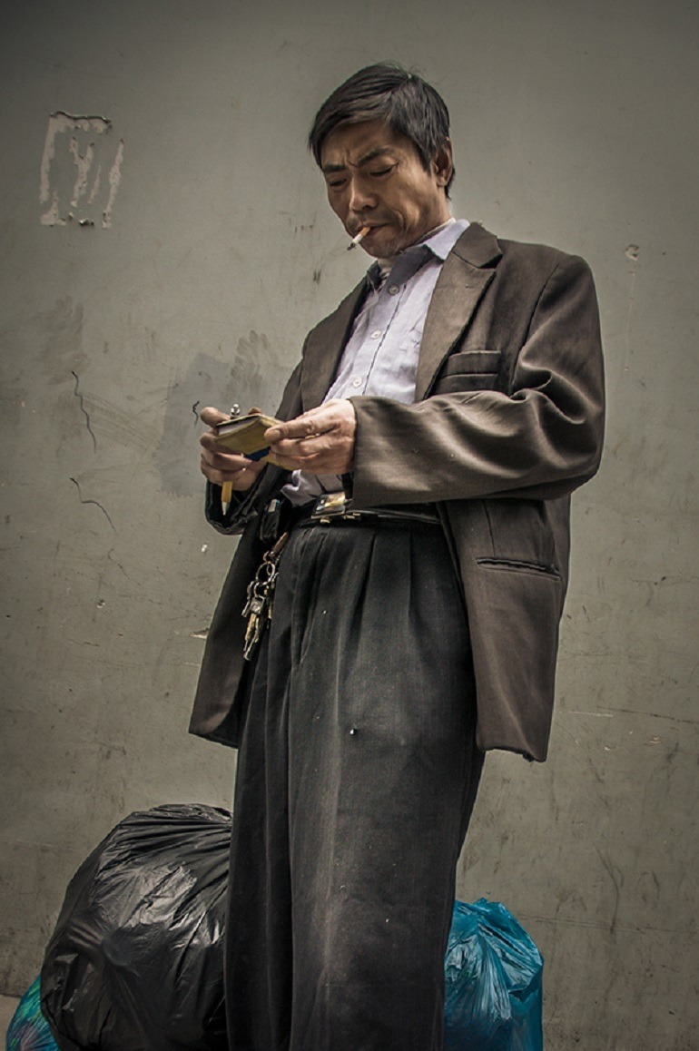 Image-Ron Gessel, a street photographer captures a Man Smoking, 'The Streets of Shanghai'.
