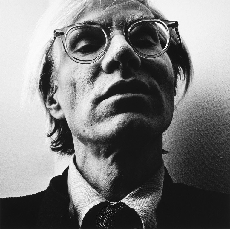 Image-  Picture of Andy Warhol, one of the leading figures of the pop art movement captures the artist from an unusal angle. Hans Gedda shows why he is a celebrated professional commecial photographer