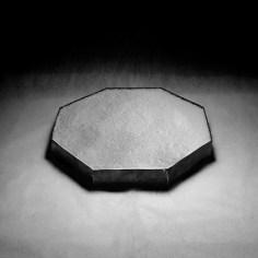 Gianni Berti, Oggetti inconsumabili - 8, 2014, piombo, sale, luce, cm 32x32x6 + installazione