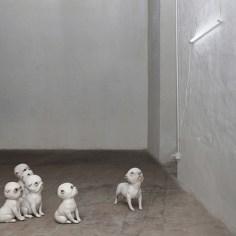 Monica Grycko, Dogmaster, 2014, tecnica mista (ceramica, resina epossidica, vetro, lampada neon), cm 35x25x30 cad.