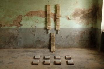 Untitled, 2016, misure ambientali, carta, paraffina, mattonelle di cotto antico