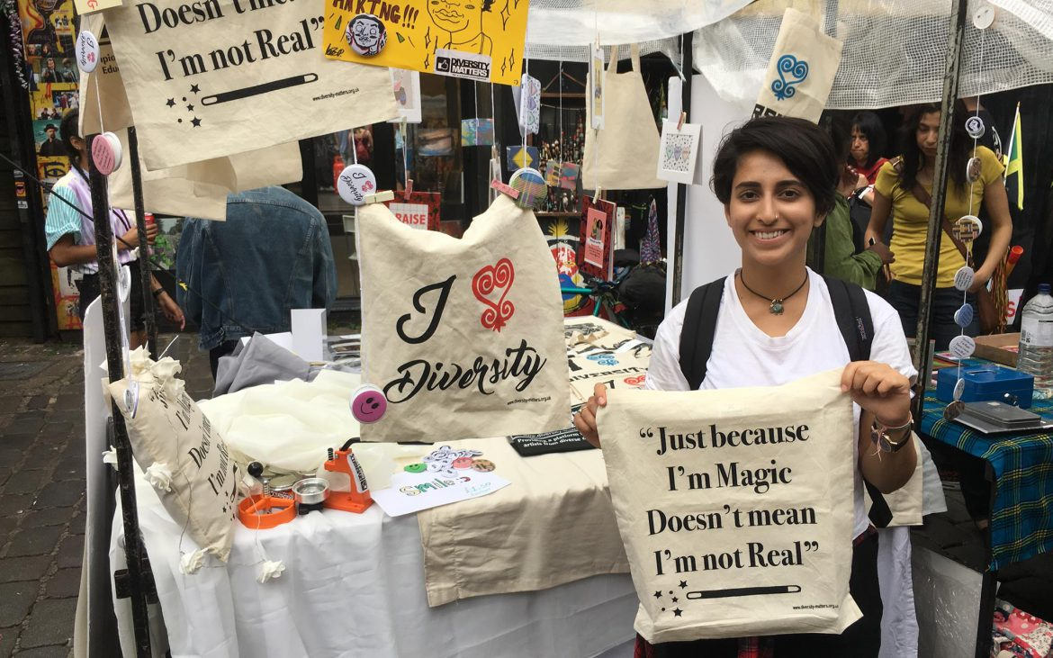 A happy customer at Divercity Arts Project stall