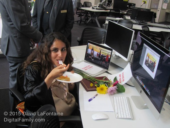 """Priyanka Deo indulges in some of the tasty chow, while also ignoring the """"Don't Touch!"""" sign to do a few final touches on a project. Or was that Facebook again? (taps foot, arches eyebrow)"""