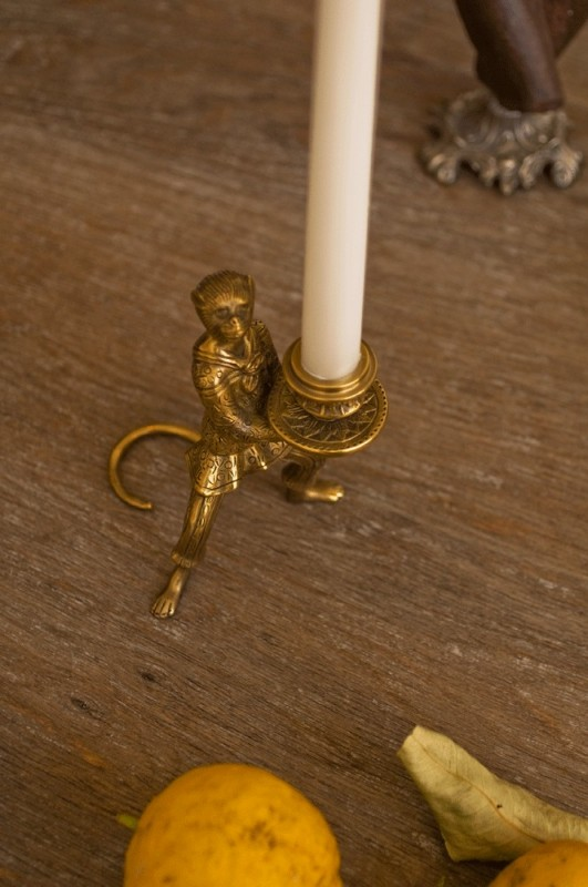 funny candle holdermade in brass little Monkey trained