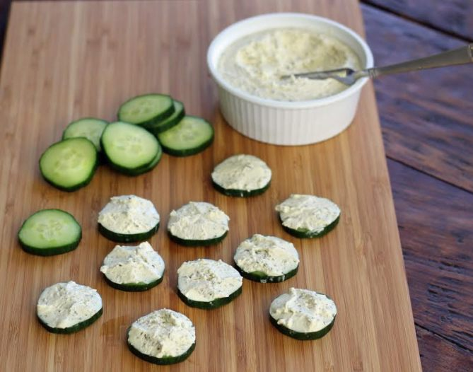 Elegant Cucumber Bites - Spreading on the Herbed Cheese Artful Dishes