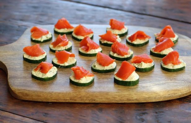 A Tray of Beautiful Cucumber Bites with Herbed Cheese and Smoked Salmon Artful Dishes