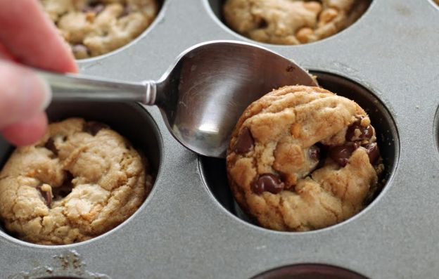Removing the Cookies from the Muffin Pan with a Spoon Artful Dishes