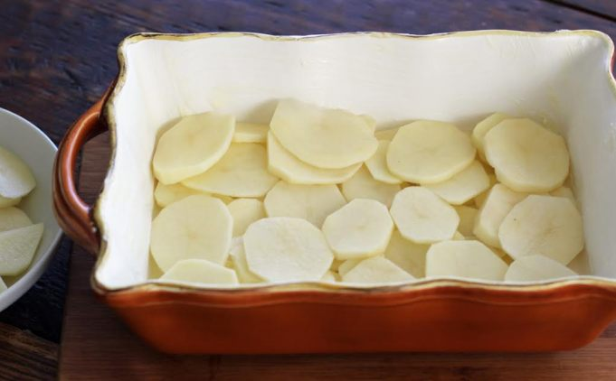 Layering the Potatoes for Scalloped Potatoes Artful Dishes