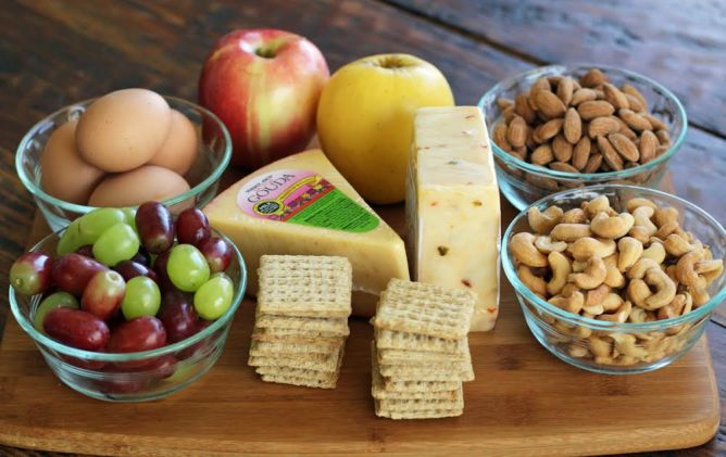 Ingredients for Protein Box Lunches Cashews Hard Boiled Eggs Apples Grapes Cheese and Crackers | artfuldishes.com